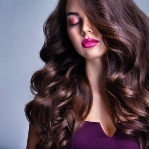 Fashion model with wavy hairstyle.