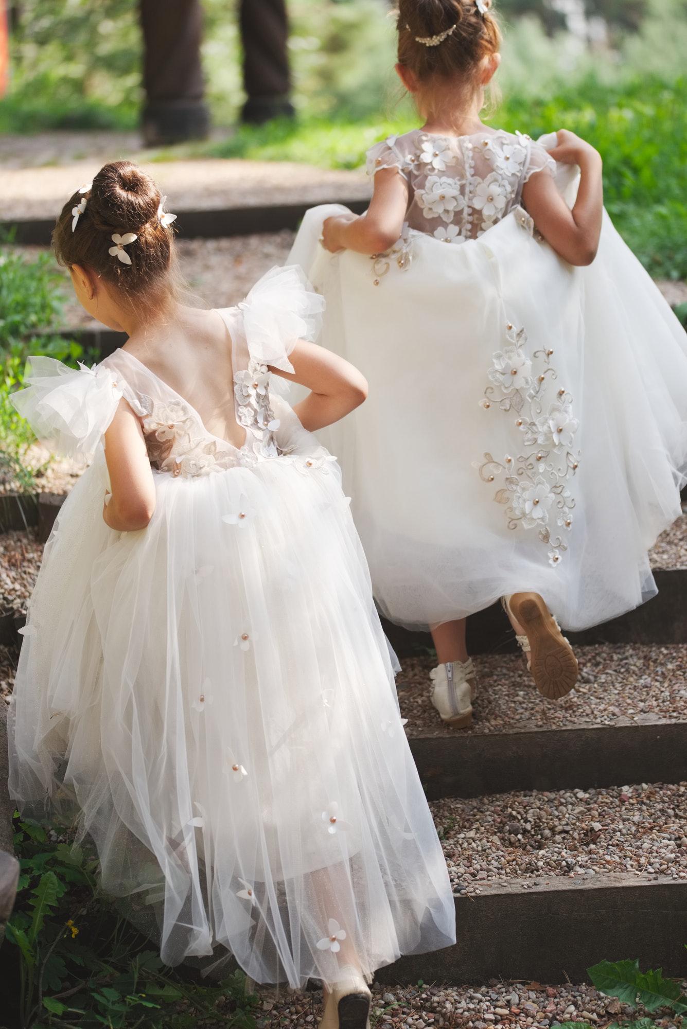 happy beautiful girls with white wedding dresses